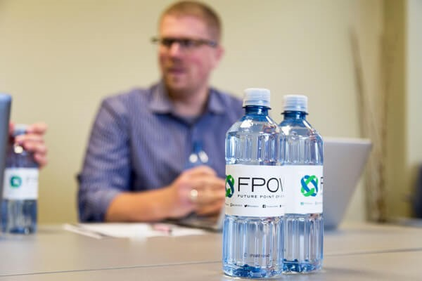 Single use plastic water bottles on a conference table